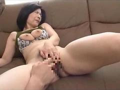 Shy Asian milf gets fondled and fingered on a couch