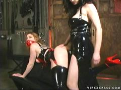 Mistress in latex punishing slavegirl
