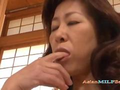 Cute Asian MILF is on her knees giving head