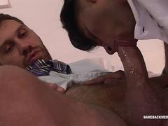 A hunk is getting his cock swallowed by a twink and then he screw him