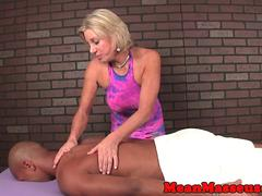 Mean mature masseuse smokes and tugs blackguy