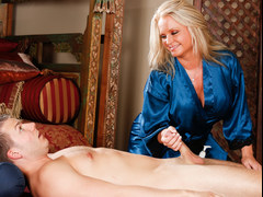 Maya Devine massaging a younger guy