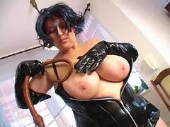 Busty dominatrix Baraca in a latex corset and a whip