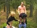 Two girls and boy in forest video