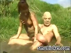 Slut fucked in the mud
