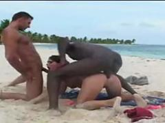 Interracial threesome on the beach is so very nice