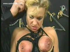 German master shouts at slave and spanks her on her tits which a tied with a rope
