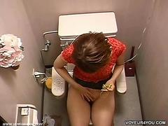 Indecent women toilet onanism