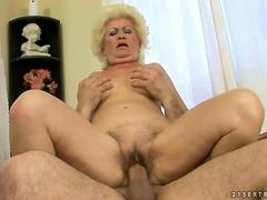 Ugly old bitch riding a huge thick cock