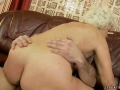 Hairy granny likes to get her wet pussy even wetter