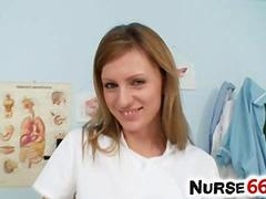 Pervy nurse Olga Barz likes to stretch her cunt with 2 dildos