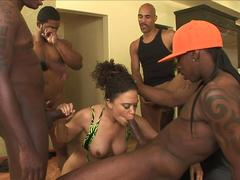 Adventurous ebony whore gets into a blowbang and gives a round of blowjobs