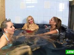 Glam babes get their clothes soaking wet