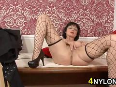 Mature Woman Wearing Lingerie And Fishnets