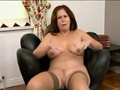 Raunchy MILF in stockings gets naked to tease and masturbate
