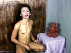 Slim ladyboy strips off and plays with her massive dick head