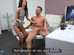 Female agent drawing on naked guy in casting