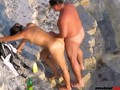 Kinky couple enjoying some naughty things on voyeur beach