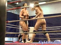 Lesbian babes wrestle in a boxing ring