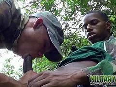 gay soldiers take turns at outdoor oral film