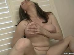 Busty Kitty playing her pussy with dildo