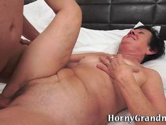Horny granny knows how to satisfy her young lover by sucking his huge cock and then spreading her legs for him