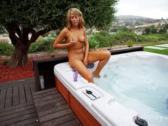 curly-hair-hottie-masturbates-in-hot-tub