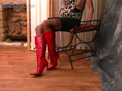 Kinky brunette Milf teases her tits nylon legs little panties and sexy red high heeled leather boots