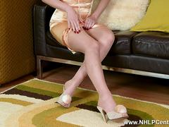 Brunette Sophia Smith strips down to retro nylons stiletto heels and vintage lingerie