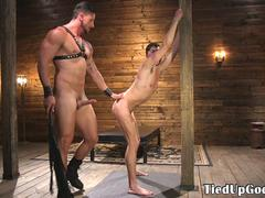 Bondage stud gagging while getting flogged