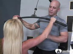 Blonde gets help from the gym instructor