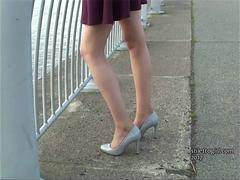 Leggy brunette teases long legs in high heel shoes fetish