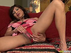 American temptress Selena masturbating on the couch