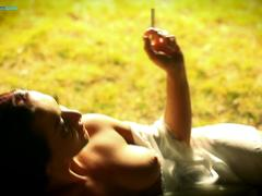 Sandra Romain smokes a cigarette and masturbates in the park