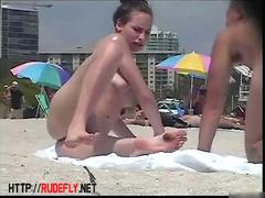 Stripped breasty honey widens legs at the beach