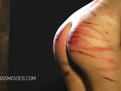 Slut mercilessly whipped by dominatrix