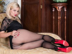 Curvy blonde Bad Dolly gets out big tits teases and rips sheer black pantyhose open