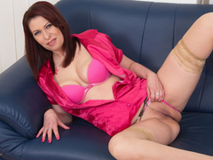 Mature brunette undressing and pleasuring herself