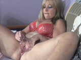 Mature slut Liisa is stuffing her wet twat with a toy