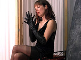 Posh leggy brunette milf in nylon stockings enjoys the feeling of her soft black leather gloves